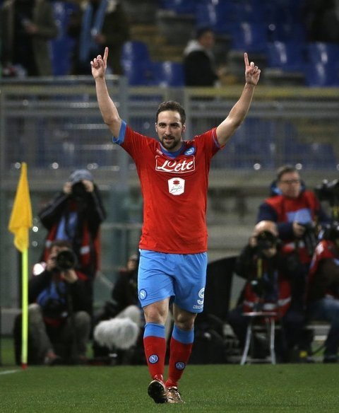 Napoli's Gonzalo Higuain celebrates after scoring during a Serie A soccer match between Lazio and Napoli at Rome's Olympic stadium, Wednesday, Feb. 3, 2016. (AP Photo/Alessandra Tarantino)